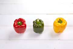 Fresh colorful bell pepper box on wooden table. Top view Royalty Free Stock Photography