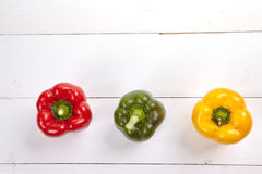 Fresh colorful bell pepper box on wooden table. Top view Stock Image