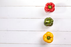 Fresh colorful bell pepper box on wooden table Royalty Free Stock Photo