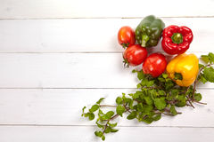 Fresh colorful bell pepper box on wooden table Royalty Free Stock Photos
