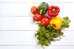 Fresh colorful bell pepper box on wooden table. Top view Royalty Free Stock Images