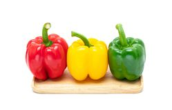 Fresh colorful bell peppers isolated on white background Royalty Free Stock Images