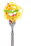 Fresh colorful composition with pasta on fork Stock Photography