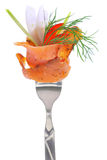 Fresh colorful composition with seafood on fork Stock Photo