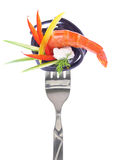Fresh colorful composition seafood with pasta on fork Stock Images