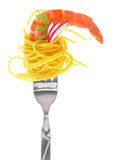 Fresh colorful composition seafood with pasta on fork Stock Photos