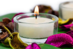 Composition of burning candles fragrant potpourri on monstera leaf royalty free stock image