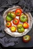 Fresh tomatoes on dark background. Top view Stock Photo