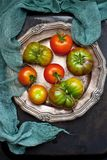 Fresh tomatoes on dark background. Top view Stock Image