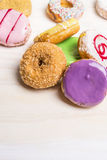 Fresh colorful donuts on white wooden background, close up. Fresh colorful donuts white wooden background, close up royalty free stock photos