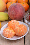 Fresh colorful fruits composition mandarin, strawberry, peach, bananas and orange Stock Images