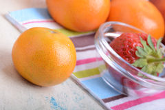 Fresh colorful fruits composition mandarin, strawberry, peach, bananas and orange Royalty Free Stock Photography