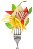 Fresh colorful fruits on fork Stock Photography