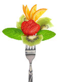 Fresh colorful fruits on fork Stock Photos
