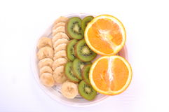 Fresh colorful fruits on the plate, macro. Fresh fruits on plate  on white backgorund Stock Photography