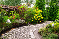 Fresh colorful garden. With stone path Stock Photos