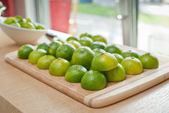 Fresh colorful, green limes limes on a tray. Colorful cutted limes on a tray Royalty Free Stock Images