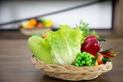 Fresh colorful organic vegetables in basket royalty free stock photos