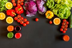 Fresh colorful organic vegetables and set of homemade different drinks on a black background. stock images