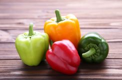 Fresh colorful pepper on a brown background royalty free stock photo