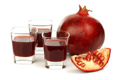 Fresh colorful pomegranate and glasses of juice Stock Photography