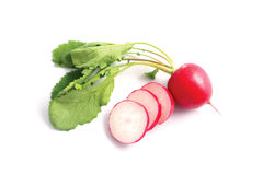 Fresh colorful radish isolated on a white background with sliced pieces. Royalty Free Stock Images