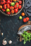 Fresh colorful ripe heirloom tomatoes in basket, copy space Royalty Free Stock Photos