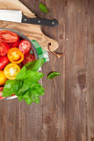 Fresh colorful tomatoes and basil in colander Stock Photos