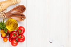 Fresh colorful tomatoes, basil and olive oil royalty free stock images