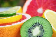 Fresh colorful tropical fruits - kiwi, lemon, lime, red grapefruit Royalty Free Stock Photos