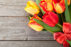 Fresh colorful tulips with ribbon and bow Stock Images