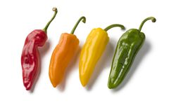 Fresh colorful variety of sweet pointed peppers. Fresh variety of red, yellow, orange and green sweet pointed peppers isolated on white background stock photos
