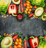 Fresh Colorful Vegetables Ingredients For Tasty Vegan And Healthy Cooking Or Salad Making On Rustic Background, Top View, Frame. Royalty Free Stock Photography