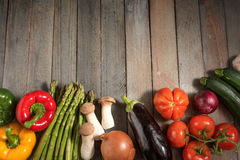 Fresh colorful vegetables on rustic wooden table. Fresh asparagus and other vegetables on rustic wooden table for a healthy nutritional concept Stock Photography