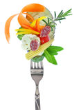 Fresh colorful vegetables and salami on fork Royalty Free Stock Photo