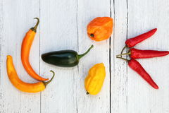 Fresh colourful assorted peppers Stock Photo