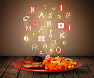 Fresh cook food with colorful letters on wood Royalty Free Stock Photos