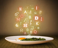 Fresh cook food with colorful letters on wood Royalty Free Stock Image