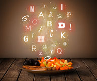 Fresh cook food with colorful letters on wood Royalty Free Stock Images