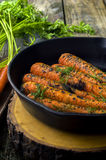 Fresh cooked carrots in a cast iron skillet Royalty Free Stock Images