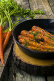 Fresh cooked carrots in a cast iron skillet Stock Images