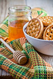 Fresh cookies in a bowl, tablecloth and honey Stock Photo