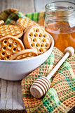 Fresh cookies in a bowl, tablecloth and honey Royalty Free Stock Image