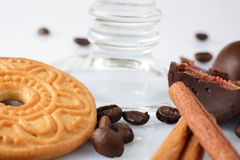 Fresh cookies with candy  and coffee beans on white background Royalty Free Stock Photography