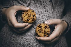 Cookies in hands royalty free stock photography