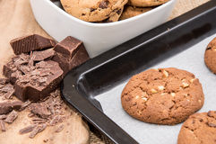 Fresh cookies on a griddle with chocolate pieces Royalty Free Stock Images