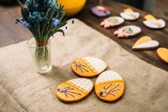 Fresh cookies with pictures on burlap litter Stock Image