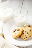 Fresh cookies on a plate with milk Royalty Free Stock Images