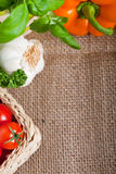 Fresh cooking ingredients on hessian Royalty Free Stock Image