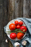 Fresh cooking ingredients from local garden on wooden background Royalty Free Stock Photography